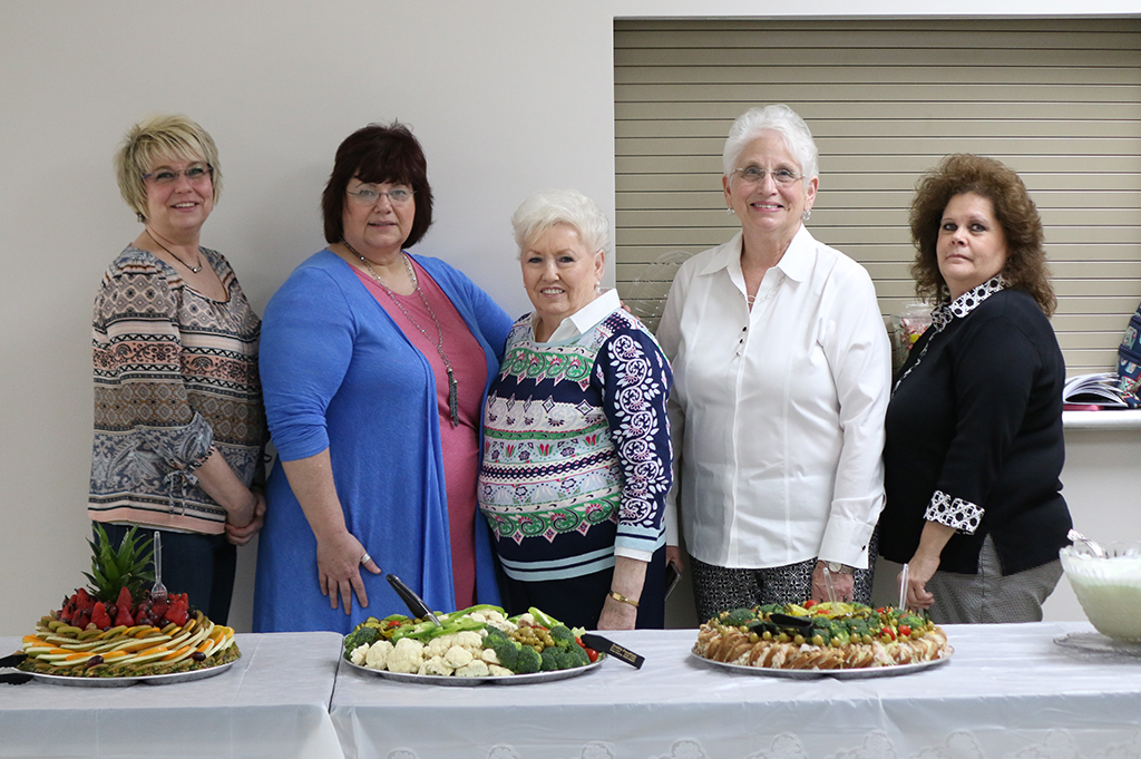 Clendenin Women's Club Members (left to right) Ktrena Goff, Renita Cadle-Gandee, Rita Lynch, Lynn Kee and Robin Fairchild provided snacks and refreshements for open house. Photo Credit: Mark Burdette