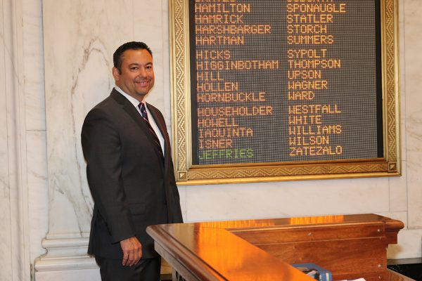 Dean Jeffries next to his name on roll call board. Photo Credit - Mark Burdette