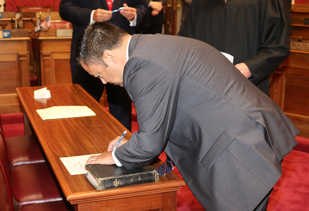 Dean Jeffries signing his oath of office agreement. Photo Credit - Mark Burdette