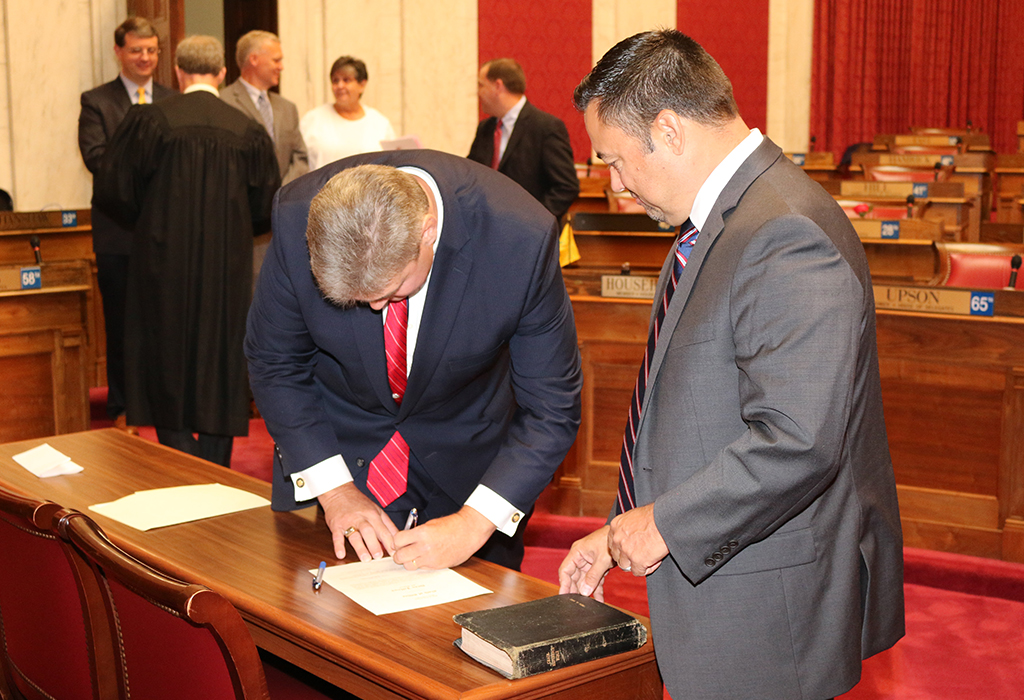 Steve Harrison signing Dean Jeffries oath of office agreement. Photo Credit - Mark Burdette