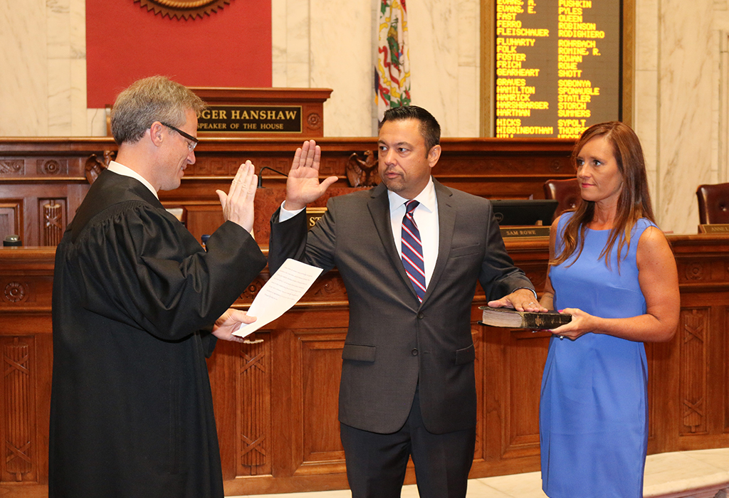 Judge Dan Greear swearing-in Dean Jeffries with Stacey Jeffries holding The Bible. Photo Credit - Mark Burdette